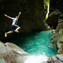 Jumping off one of the waterfalls behind the Golden Grotto near Hualian, Taiwan.