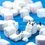 arctic animals playing on top of marshmallow icebergs