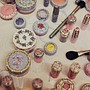 Decorated MAC cosmetics backstage at Meadham Kirchhoff spring/summer 2013.
