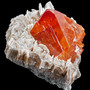 gemmy crystal of deep orange Scheelite on Muscovite