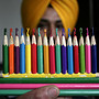Artist Harwinder Singh Gill displays a special new year message he carved into the tips of coloured pencils in Amritsar, India