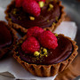 dark chocolate ganache raspberry pistachio tart