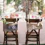 wedding-reception-signage-flower-centerpieces