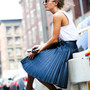 new balance and pleated skirt